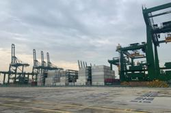 Singapore ports hire more workers, increase storage capacity to tackle global supply crisis