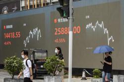 Most Asia markets up, Hong Kong swings as Evergrande sale fails