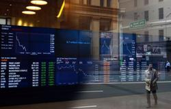Australia shares end almost flat as Evergrande worries weigh on miners
