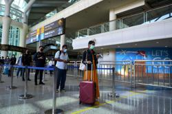 Indonesia tightens air travel curbs to brace for holiday season