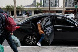 Opinion: If you can't save money, time and the planet with Uber and Lyft, then what is the point?