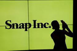 Snap shares plunge 25% as Apple privacy changes hit ads business
