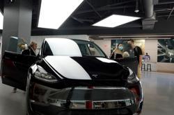 Driver was behind Tesla wheel in deadly Texas crash: investigators
