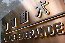 Evergrande pays overdue interest on offshore bond: state media