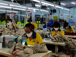 Businesses in Ho Chi Minh resume production as workers return