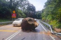 Boulder dash: Motorist has lucky escape as car ends up only lightly damaged from huge falling rock