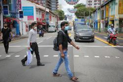 Singapore to ease curbs on movement of migrant workers in dorms from Oct 30