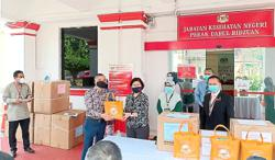 NGOs thank vaccination centre frontliners with goodie bags