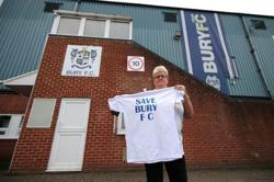 Soccer-Buyer found for Bury FC and the club's home ground