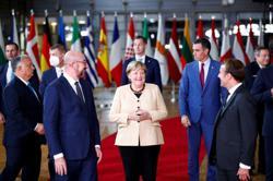 Merkel says German politics needs more women; don't ask about her blazers!