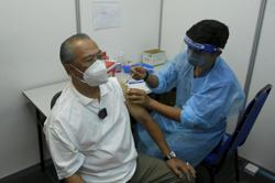 Covid-19: Muhyiddin, wife get vaccine booster doses