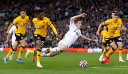 Soccer-Leeds snatch draw with Wolves as Rodrigo nets late penalty