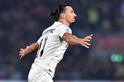 Soccer-Ibrahimovic scores at both ends as Milan beat nine-man Bologna to go top