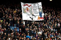Soccer-Police to investigate banner at Crystal Palace critical of Newcastle deal