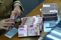 Commodity strength, economic recovery brightens Indonesian rupiah's prospects, says survey