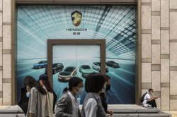 Evergrande EV unit soars after Hui pledges to shift business