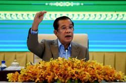 Cambodia passes law barring duel citizenship for holders of top posts