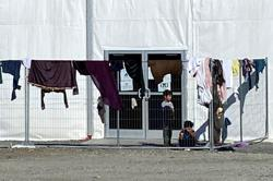 U.S. taps private groups to help resettle Afghan refugees