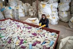 Group turns plastic waste into building material