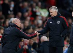 Soccer-Solskjaer survives storm of criticism after Liverpool crushing