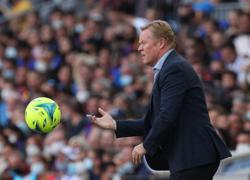 Soccer-Koeman content to enjoy the ride at Barca as pressure intensifies