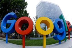 Alphabet earns record profit on Google ad surge