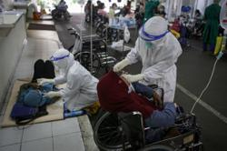 Indonesia to mandate PCR testing for all holiday season travel
