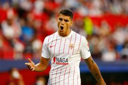 Soccer-Lamela earns point for Sevilla as they go top