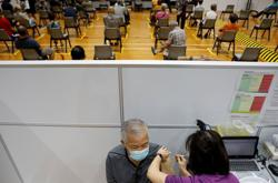 Singapore looking into unusual surge after record COVID-19 cases