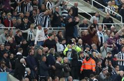Soccer-Newcastle fan who collapsed during Spurs game discharged from hospital