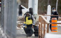 Canada defends pandemic policy on asylum-seekers while letting more enter through exemptions